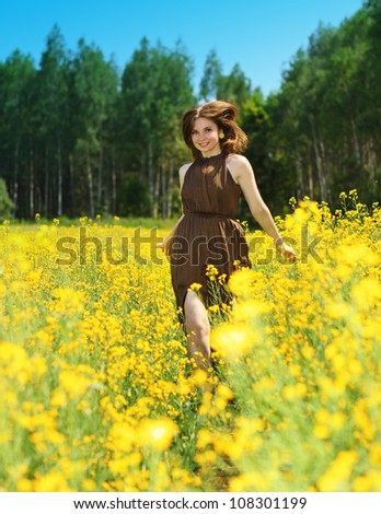 adorable woman in field - stock photo