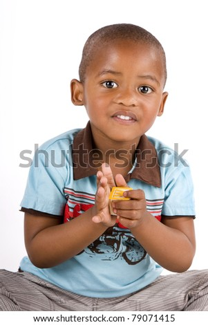 Adorable 3 year old african american or black boy playing with blocks - stock photo