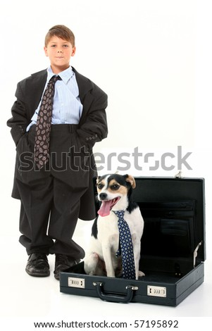 Adorable 6 year old american boy and terrier breed dog in suitcase over white background.