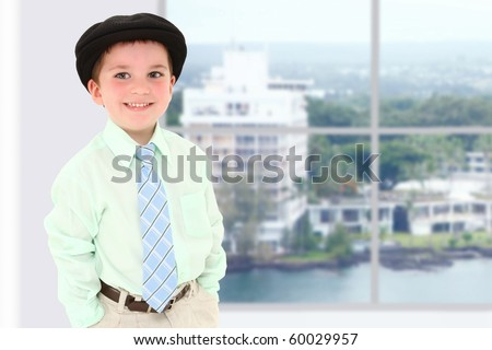 Adorable 3 year old american boy in school or office building with scene of Hawaii out window. - stock photo