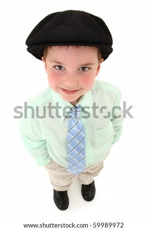 Adorable 3 year old american boy in suit and tie with black kangol looking up over white background. - stock photo