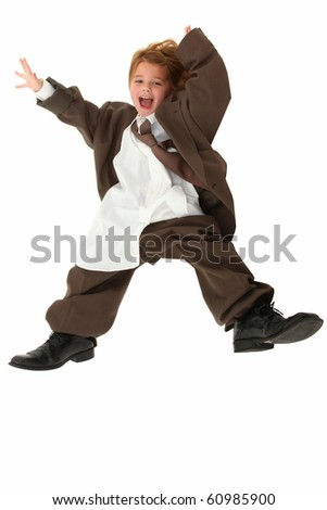 Adorable 5 year old american girl in baggy over sized business suit falling over white background. - stock photo