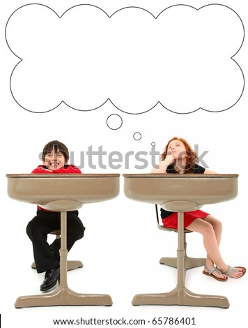 Adorable 7 year old boy and girl in old school desk over white background. Thought bubble. - stock photo