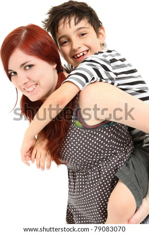 Adorable 8 year old boy getting piggy back ride from babysitter over white background. - stock photo