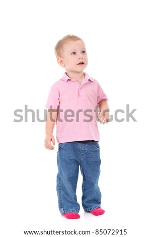Adorable 2 year old boy looking up over white background - stock photo