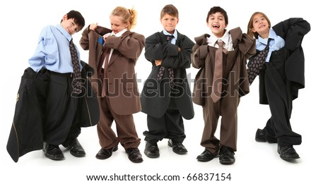 Adorable 7 year old children, boys and girls, in brown and blue baggy men's suits and big shoes over white background.