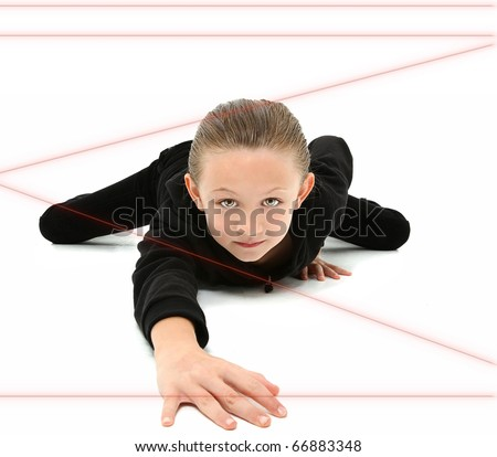 Adorable 7 year old girl dressed as spy crawling through red laser beams over white background. - stock photo