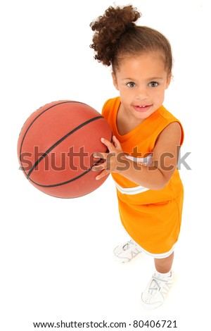 Adorable 3 year old toddler girl child in team uniform holding basketball over white background. - stock photo