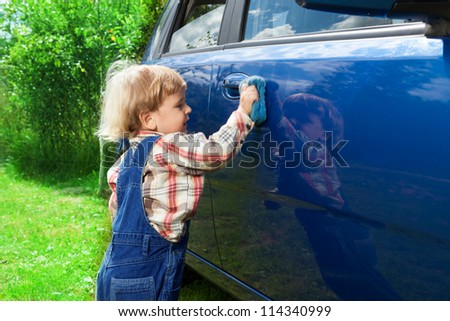 adorable 2 years old washing blue car