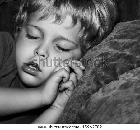 Adorable you boy taking a nap - stock photo