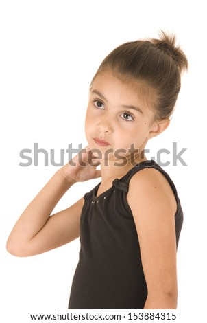adorable young ballerina girl taking a break - stock photo
