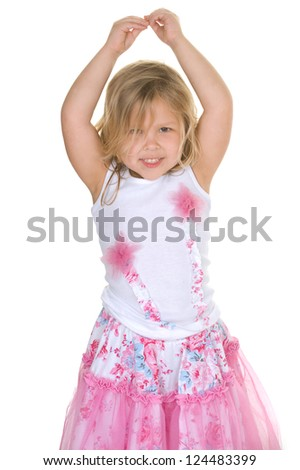Adorable young blond girl wearing a tutu outfit in the studio posing like a dancer - stock photo