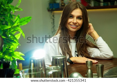 Adorable young brunette lady with green eyes and charming smile looking at the camera - stock photo