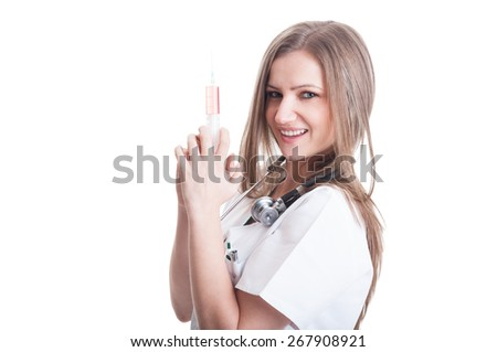 Adorable young female doctor holding a syringe isolated on white background - stock photo