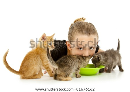 Adorable young girl child drinking out of kitten's milk bowl.  Over white background.
