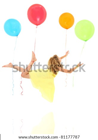 Adorable young girl child floating away on balloons with clipping path over white. - stock photo