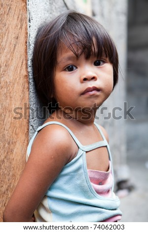 Adorable young girl in the Philippines living in poverty - stock photo