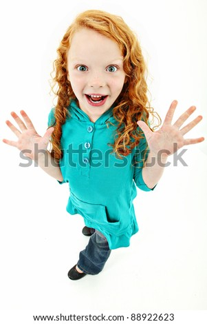 Adorable young girl standing over white background with excited expression. - stock photo