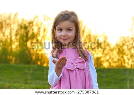 Adorable young girl with an open hand - stock photo