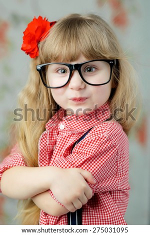 Adorable, young girl with red flower - stock photo