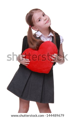 Adorable young schoolgirl with funny two tails and school bag on Education theme