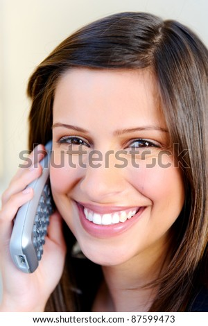 Adorable young woman talks on the phone, natural and casual