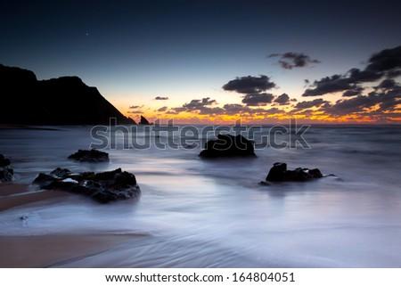 Adraga Beach Sunset, Sintra, Portugal - stock photo