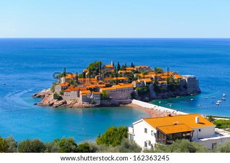 Adratic sea and the Sveti Stefan Island, south of Montengro - stock photo