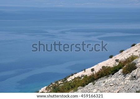 Adriatic rocky coast in Dalmatia. Mediterranean sea and rocky beach - stock photo