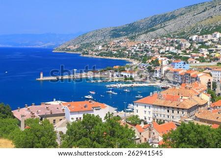 Adriatic sea and the harbor and old town of Senj, Croatia - stock photo