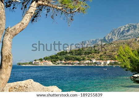 Adriatic sea at Podgora in Croatia with monument Seagull's wings and mountain Biokovo in background - stock photo