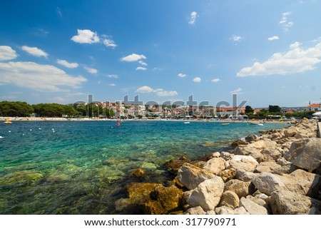 adriatic sea coast landscape with stones and rocks - stock photo