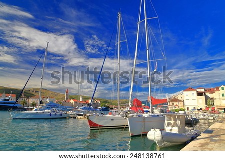 Adriatic sea harbor with sail boats by th sunny pier, Trogir, Croatia - stock photo