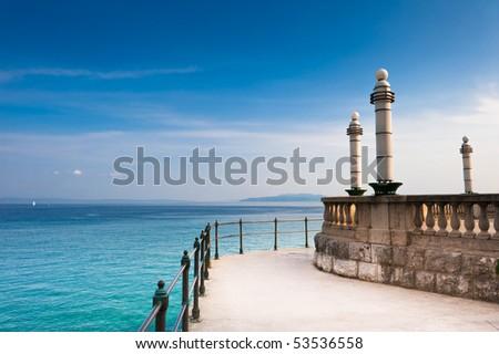 Adriatic Sea scenic view from quay of Opatija, a tourist town on Croatian coast. - stock photo