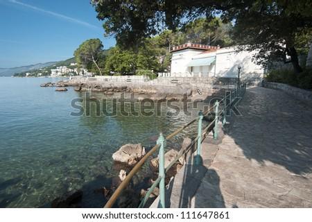 Adriatic Sea scenic view from quay of Opatija, a touristic town on Croatian coast. - stock photo