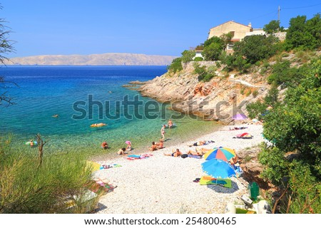 Adriatic sea shore with people tanning on sunny beach, Senj, Croatia - stock photo