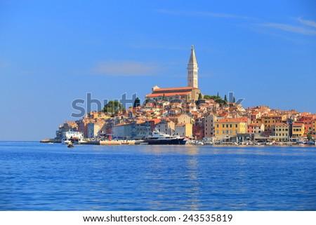 Adriatic sea surrounds Venetian old town, Rovinj, Istria peninsula, Croatia - stock photo
