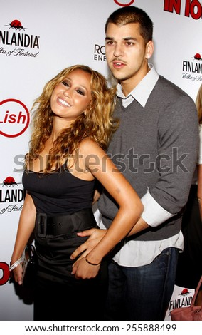 Adrienne Bailon and Robert Kardashian Jr. attend the Summer Stars Party 2008 held at the Social in Hollywood, California, United States on May 22, 2008.  - stock photo