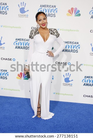 Adrienne Bailon at the 2012 American Giving Awards held at the Pasadena Civic Auditorium in Pasadena on Decmber 7, 2012.  - stock photo