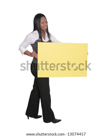 adult African American female holding a blank yellow sign over white - stock photo