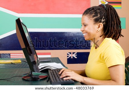 adult african american student suing computer - stock photo