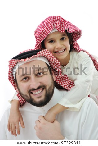 Adult and child with middle eastern clothes - stock photo