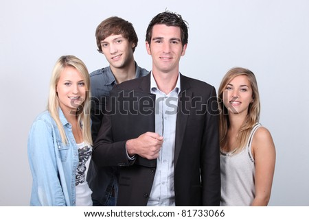 Adult and teenagers smiling - stock photo