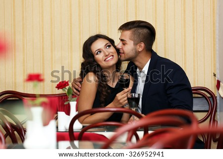 adult beautiful couple cheers at the restaurant - stock photo