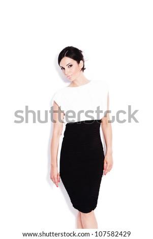 adult beautiful woman in elegant black and white dress studio white - stock photo