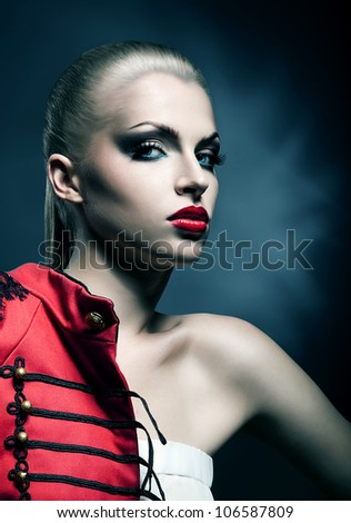 adult blonde sexy woman wirh red lips in red jacket