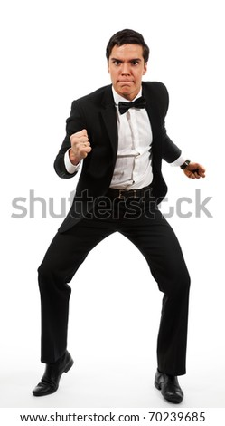 Adult business man prepared to fight clench his teeth to grimace on his face, wearing formal costume - stock photo
