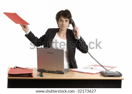 adult business woman at her desk - stock photo