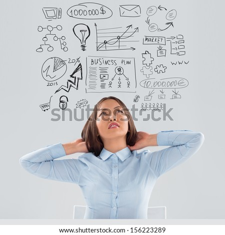 Adult business woman thinking of her plans - stock photo