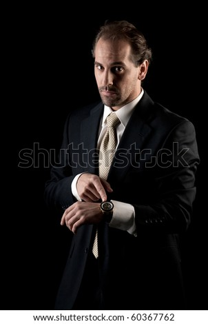 Adult businessman pointing to clock, arrive late deadline concept - stock photo